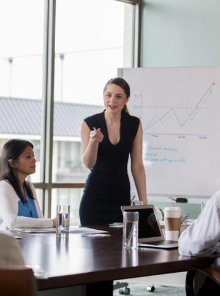 Woman-in-room-giving-presentation.jpg